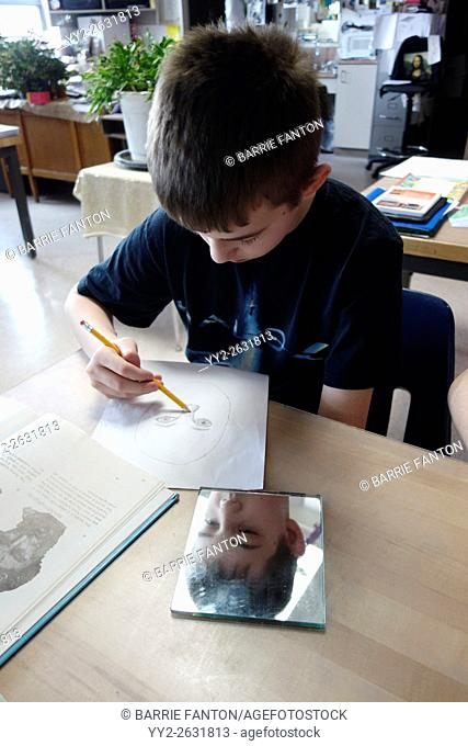 6th Grade Boy Drawing Self-Portrait With Mirror, Wellsville, New York