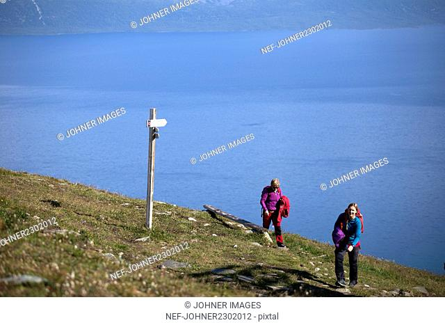 Two women trekking in mountains
