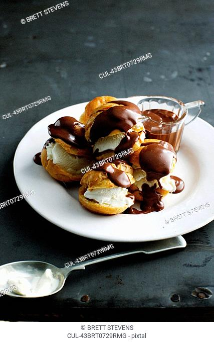 Plate of cream puffs with chocolate