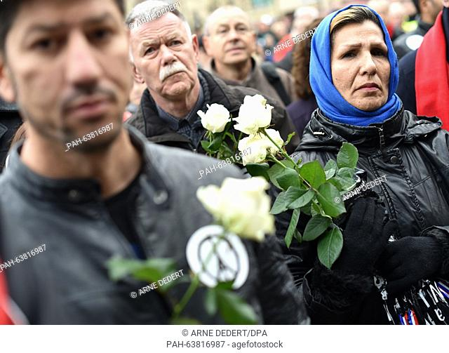 People of various religious groups have gathered for a commemorative rally held for the victims of the Paris terror attacks, at the Freiheitsplatz in Hanau