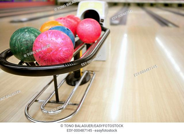 Bowling colorful balls and wooden floor perspective