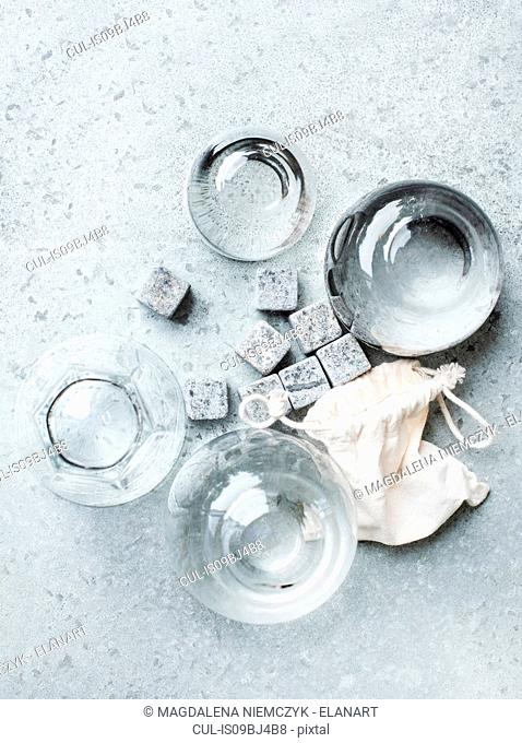 Empty glasses and whiskey stones, overhead view