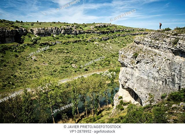 Hiker beside the abiss. The river Pisuerga and the canyon of La Horadada as it passes through the Las Tuerces Natural Monument