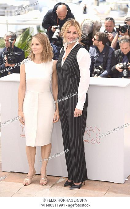 US director Jodie Foster (l) and US actress Julia Roberts attends at the photocall for 'Money Monster' at the 69th Annual Cannes Film Festival at Palais des...