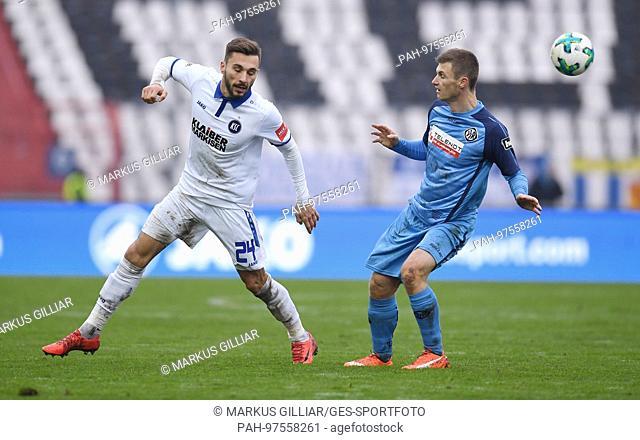 duels / Duell Fabian Schleusener (KSC) versus Thomas Geyer (Aalen). GES/ Fussball/ 3. Liga: Karlsruher SC - VfR Aalen, 02.12