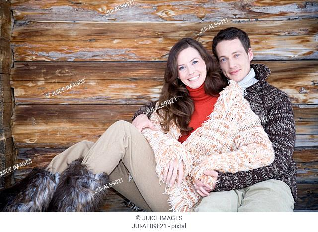 Couple in winter clothing hugging