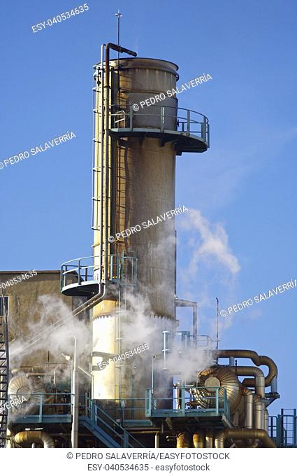 Old smokestack with blue and clear sky