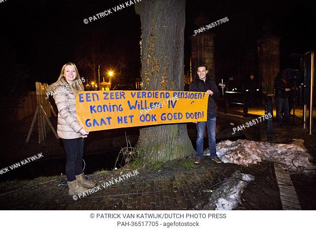 People hold a banner reading 'A well deserved retirement! King Willem IV will do good as well!' at Palace Huis ten Bosch