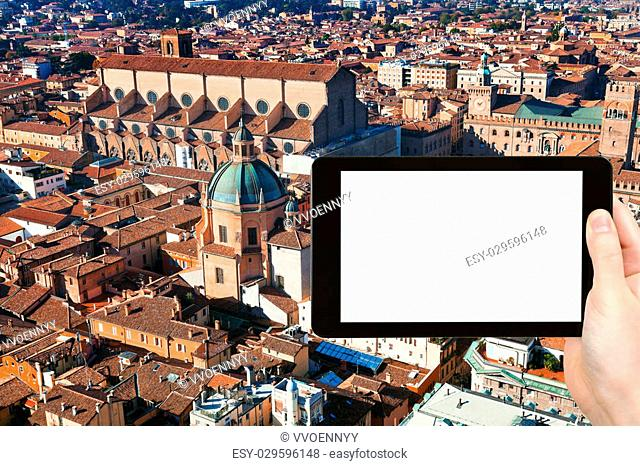 travel concept - tourist photograph above view of The Basilica of San Petronio in Bologna, Italy on tablet pc with cut out screen with blank place for...