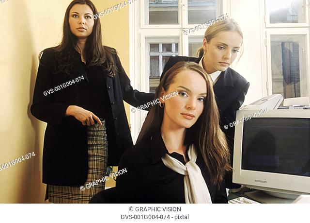 Three young women in an office together