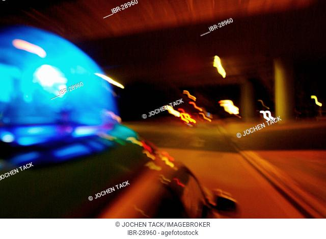 DEU, Germany, Essen: Police patrol car on a alarm mission, with blue light. Daily police life. Officer from a city police station