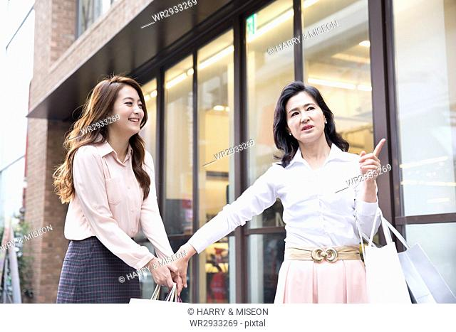 Mother and daughter at shopping street