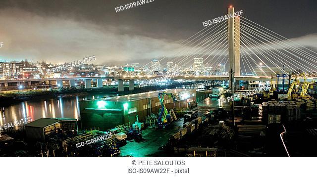 Cityscape of Tacoma Narrows bridge and the Narrows at night, Tacoma, Washington, USA