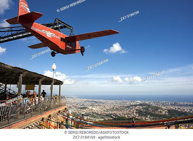 Airplane carousel in Tibidabo Amusement Park, Tibidabo, Barcelona, Spain. The Tibidabo theme park, Barcelona, Spain. Tibidabo is a mountain overlooking...