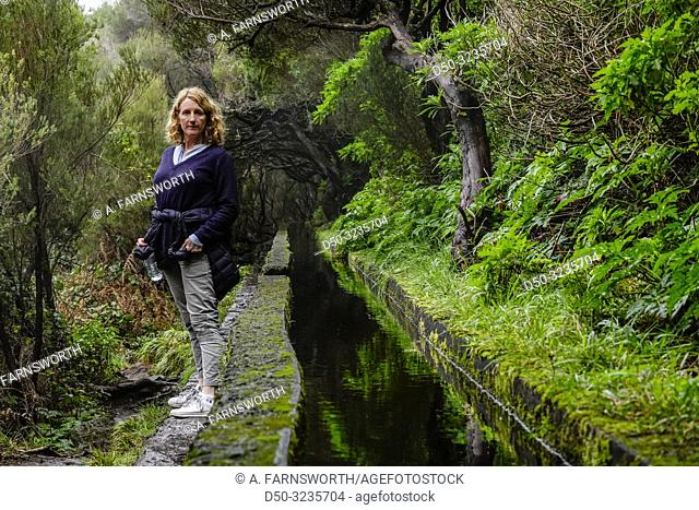 Levada 25 fountains, Rabacal, Madeira, Portugal A woman hiker on this famous 5 kilometer walk along levadas to waterfalls in pristine wilderness
