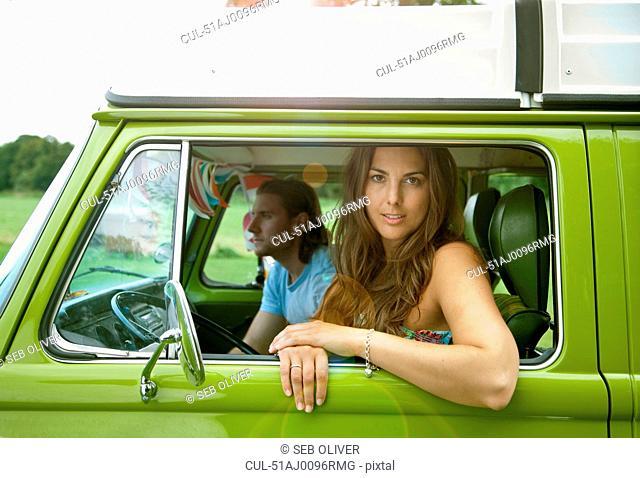 Couple sitting in van