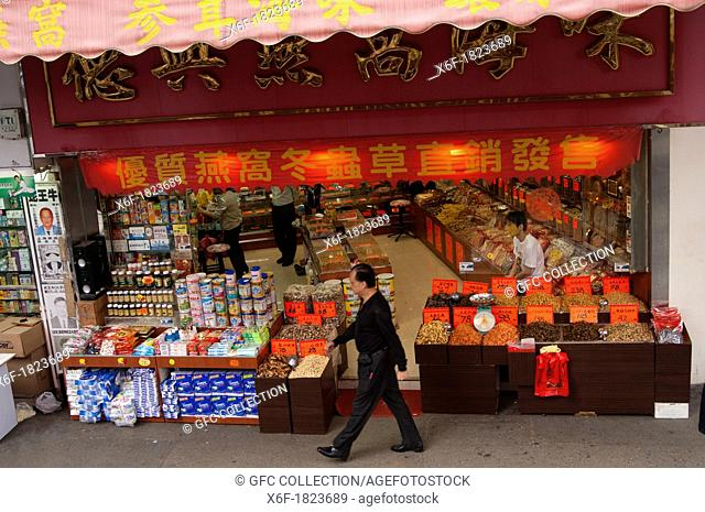 Street scene in front of a convenience store, Kowloon, Hong Kong