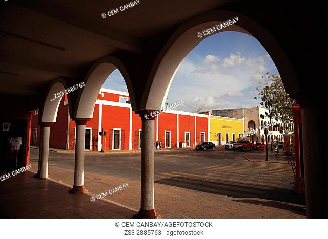 Framed view to the main square with colonial buildings at the background, Valladolid, Yucatan Province, Mexico, Central America