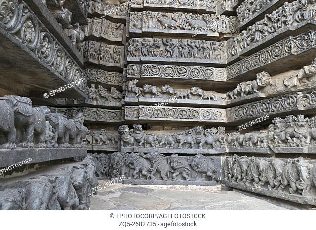 Friezes of animals, scenes from mythological episodes from Ramayana and Mahabharata, at the base of temple, Hoysaleshwara temple, Halebidu, Karnataka, india