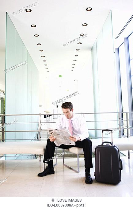 A businessman waiting at an airport
