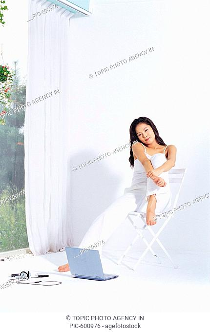 Young Woman Sitting On Chair,Korean