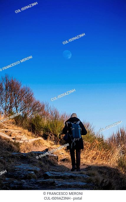 Rear view of senior woman hiking in mountains, Monte Generoso,Ticino, Switzerland