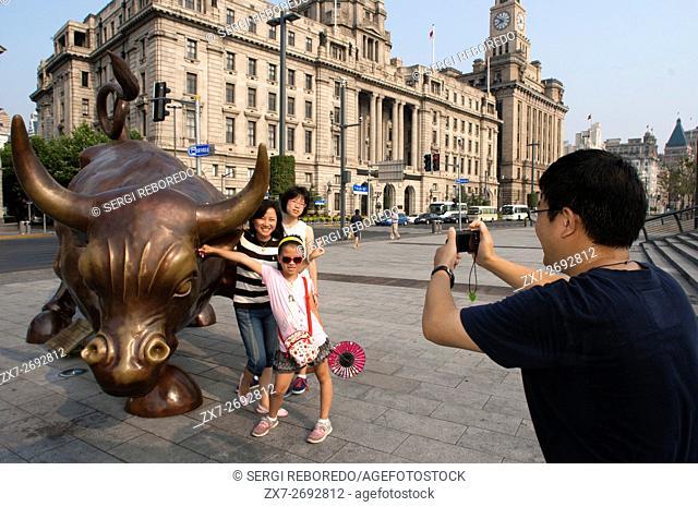 Shanghai Bull Sister of Wall Street Bull. Bronze sculpture of bull on The Bund in Shanghai China. Charging Bull statue by Arturo Di Modica (called Shanghai Bull