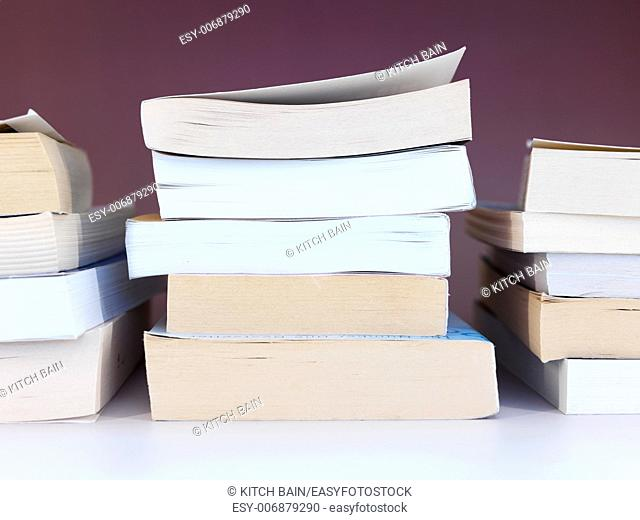 A close up shot of a pile of books