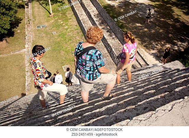 Tourists climbing up to the Great Pyramid at the Prehispanic Mayan city of Uxmal Archaeological Site, Yucatan Province, Mexico, North America