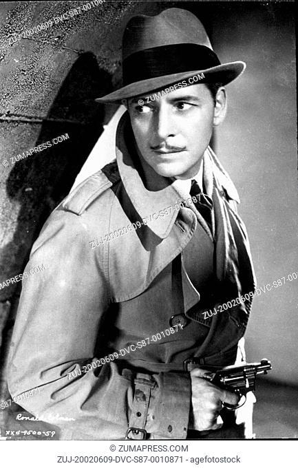 1934, Film Title: BULLDOG DRUMMOND STRIKES BACK, Director: ROY DEL RUTH, Studio: FOX, Pictured: RONALD COLMAN, GUN CRAZY, HAND GUN, WEAPONS, GUN, HIDING