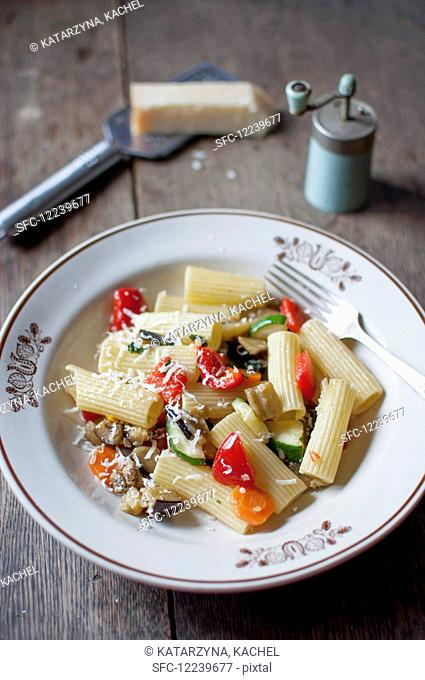 Rigatoni ortolana. Pasta with vegetables (zucchini, eggplant, red pepper, carrot, tomatoes, garlic and onion). Served with grated parmesan cheese and freshly...