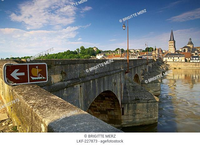 Old town of La-Charite-sur-Loire, stone bridge over the Loire river, Church and former monastery Notre Dame in the background, The Way of St
