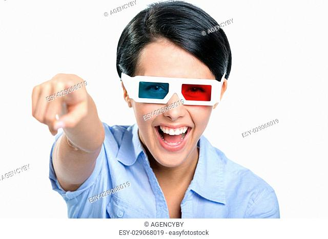 Pointing with forefinger girl in 3D glasses watches the movie, isolated on white