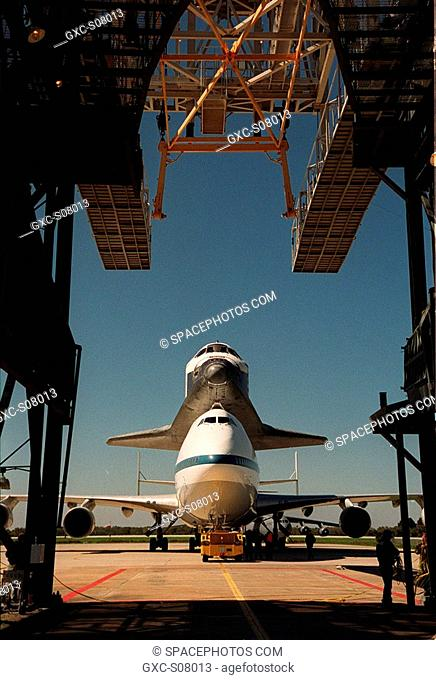 03/05/2001 --- Viewed from behind the mate/demate device at the Shuttle Landing Facility, the Shuttle Carrier Aircraft and the orbiter Atlantis are towed toward...