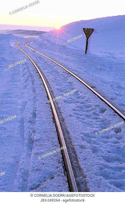 Rail in a winter sunset. Harz. Brocken. Germany