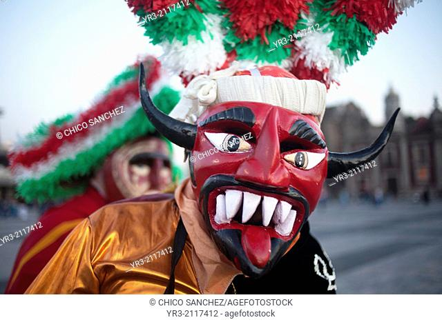 A dancer from Chocaman, Veracruz, dressed as a red devil, dances the Danza de los Santiagos at the pilgrimage to Our Lady of Guadalupe Basilica in Mexico City