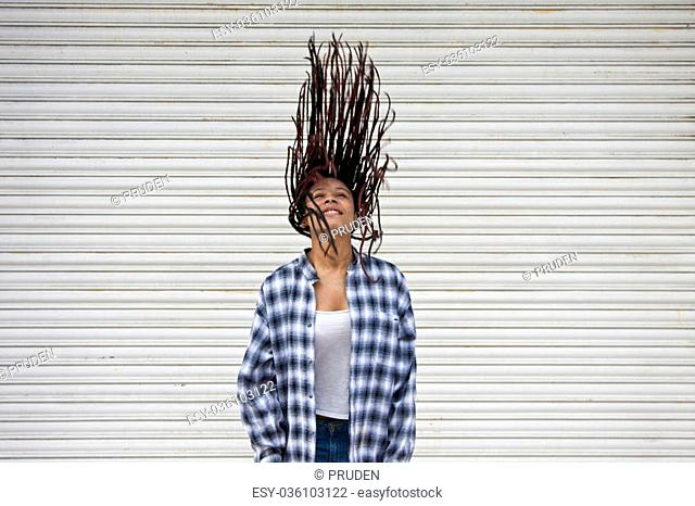 girl in the street with hair in the wind