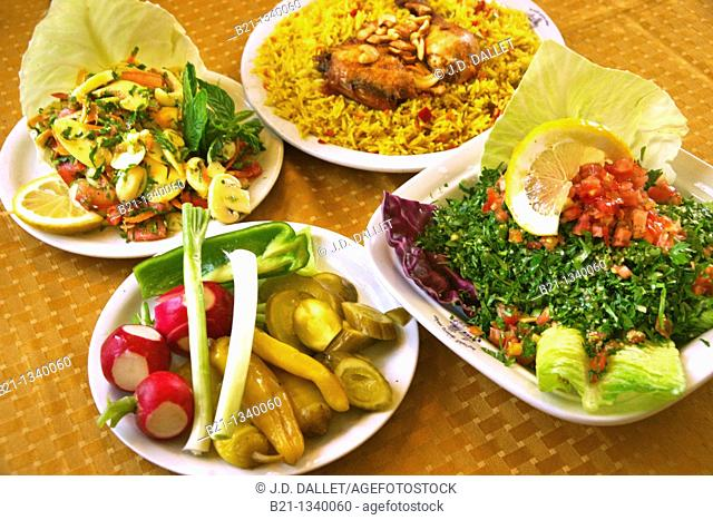 Food: mushroom salad, pickles, chicken with rice and taboule. Damascus, Syria