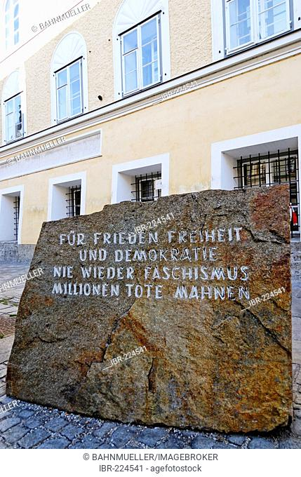 Memorial stone against war and fascism in front of the birth place of Adolf Hitler Braunau upon the river Inn Upper Austria