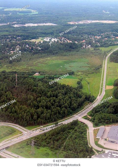 Aerial image of highway, nature and suburb in Finland