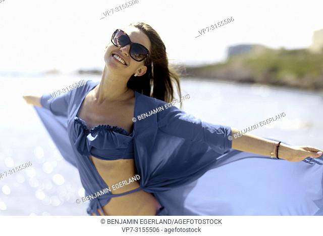 Woman in blue dress by the sea. Crete, Greece