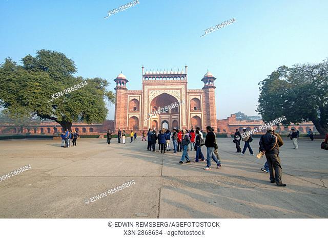 Tourists walking around the Taj Mahal complex entrance in Agra, India