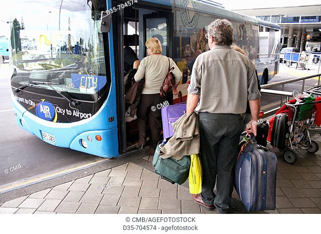 Passengers getting into airport shuttle bus, Auckland International Airport, Manukau Bay, North Island, New Zealand