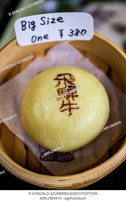 Miyagawa Asaichi Market. Dough balls with onions and meat inside. Takayama, Hida Region, Gifu Prefecture. Japan