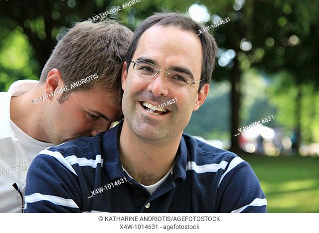 Affectionate outdoor portrait of two gay men