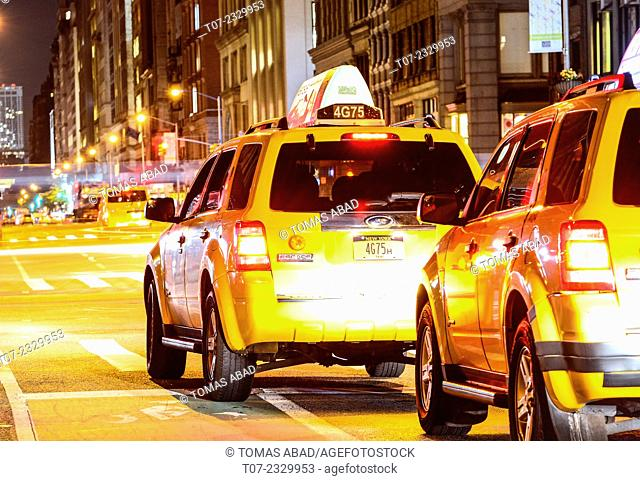Yellow Taxi on 5th Avenue in the mid 20's, Lower Manhattan, New York City, USA