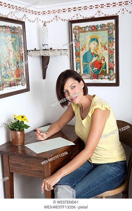 Germany, Bavaria, Woman writing letter, portrait