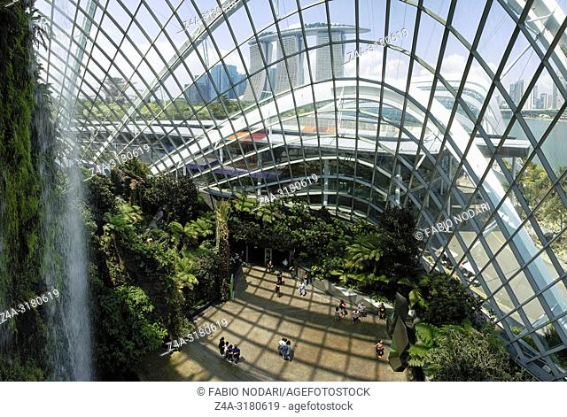 Inside the Cloud Forest Dome Gardens by the Bay in Singapore. On background the Marina Bay Sands hotel