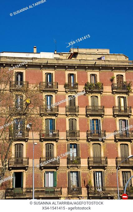 Facade with balconies of building in Passeig Sant Joan, Barcelona, Spain, Europe