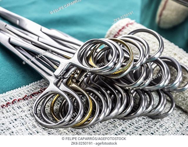 Surgical scissors on a bandage, conceptual image, horizontal composition